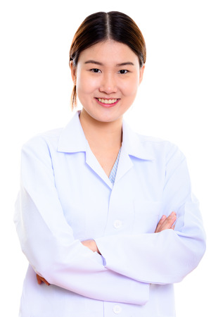 Young happy Asian woman doctor smiling with arms crossed