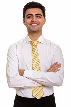Young happy Persian businessman with arms crossed