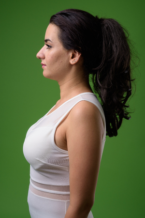 Portrait of beautiful Iranian woman against green background Stock fotó