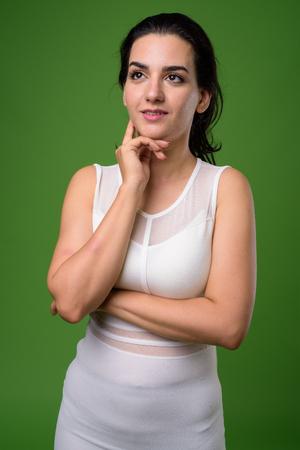 Portrait of beautiful Iranian woman against green background Stok Fotoğraf