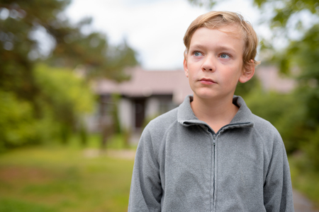 Young Blonde Handsome Boy Thinking At Home Outdoors Stock Photo