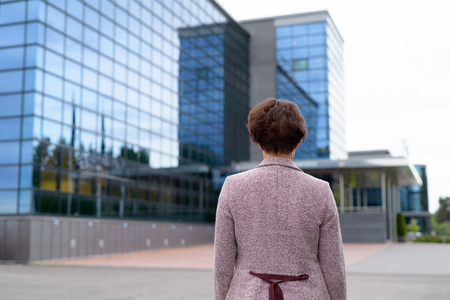 Rear View Of Mature Businesswoman Looking At The View Of The City