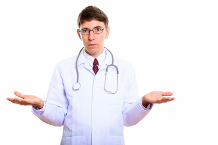 Studio shot of man doctor looking confused