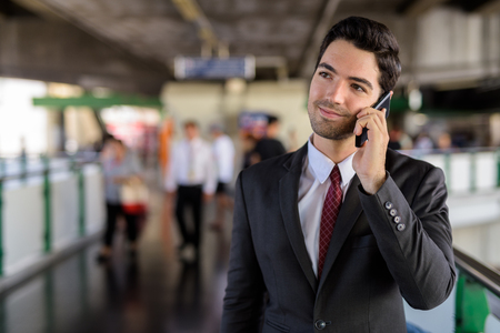 Portrait of businessman in city talking on mobile phone Stock Photo