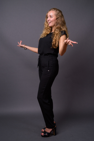 Young beautiful businesswoman with long wavy blond hair against Stock Photo