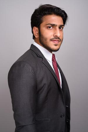 Portrait of Indian businessman against gray background Stock fotó