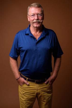 Handsome senior man with mustache wearing eyeglasses Standard-Bild