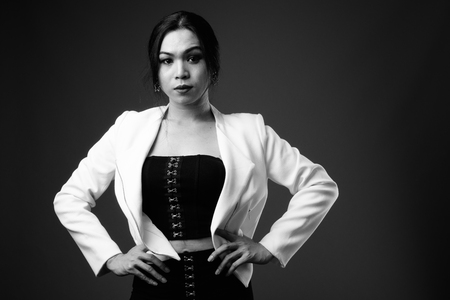 Young beautiful Asian transgender businesswoman in black and whi