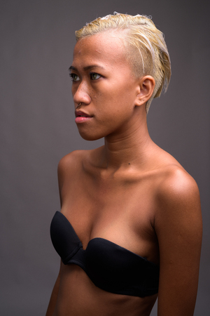 Young beautiful rebellious woman with short hair Stock Photo