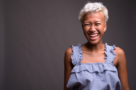 Young beautiful rebellious woman with short hair laughing