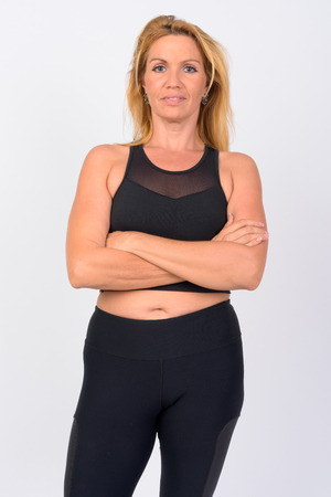 Portrait of mature woman with arms crossed ready for gym