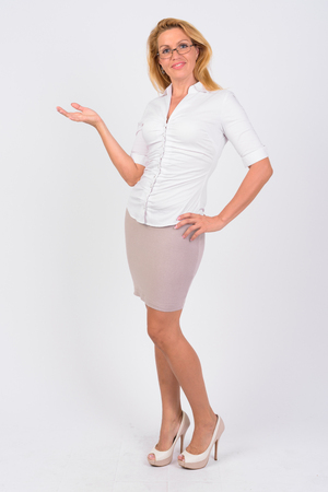 Portrait of happy mature businesswoman showing something