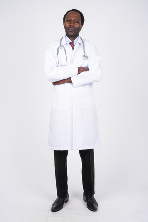 Full body shot of African man doctor with arms crossed Banco de Imagens