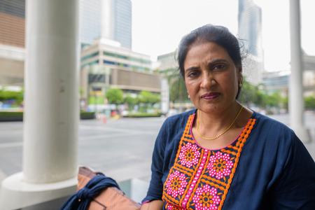 Mature beautiful Indian woman exploring the city of Bangkok, Tha