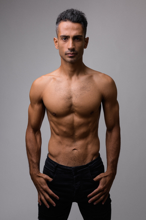 Portrait of young muscular Persian man shirtless