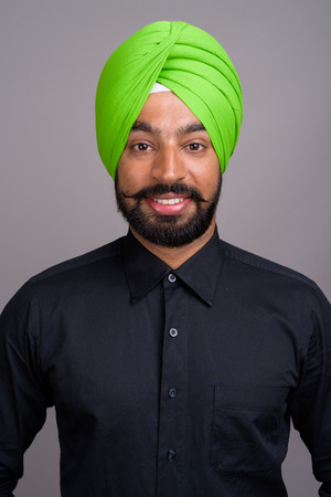 Young Indian Sikh businessman wearing green turban