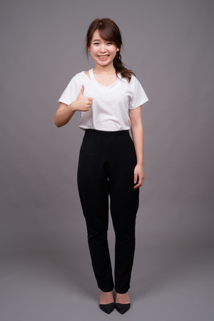 Full length shot of young Asian woman standing Stock Photo