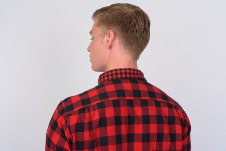 Rear view of young hipster man with blond hair