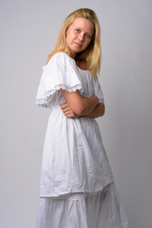 Profile view of young beautiful woman with arms crossed Stock Photo