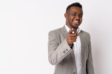 Portrait of happy young African businessman pointing at camera
