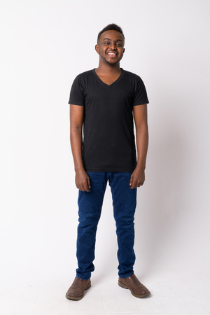 Full body shot of happy young African man smiling