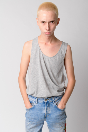 Portrait of young serious androgynous man with nose ring Archivio Fotografico