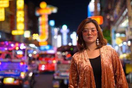Young beautiful Asian tourist woman at Chinatown in Bangkok