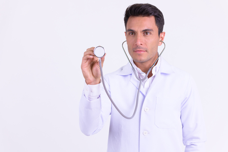 Young handsome Hispanic man doctor using stethoscope