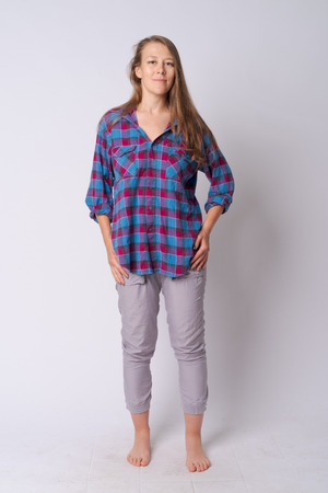 Full body shot of young beautiful hipster woman