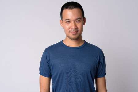 Portrait of young Asian man with short hair Stock Photo