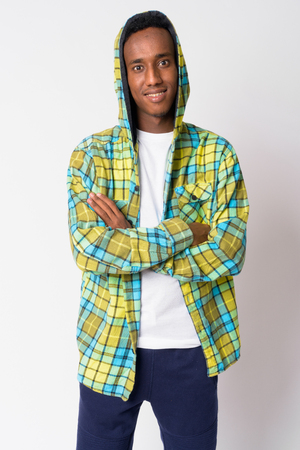 Young happy African hipster man wearing hoodie with arms crossed