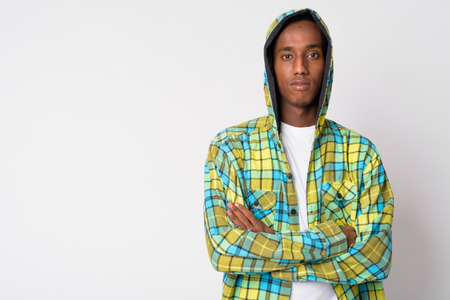 Young handsome African hipster man wearing hoodie with arms crossed