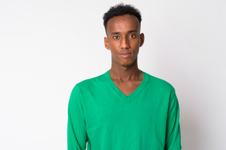 Portrait of young handsome African man looking at camera