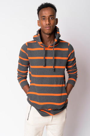 Portrait of young handsome African man wearing hoodie