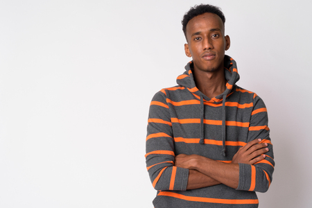Portrait of young handsome African man with arms crossed