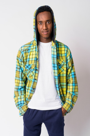 Young happy African hipster man smiling and wearing hoodie