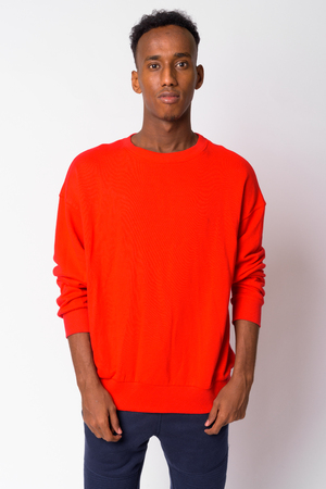 Portrait of young handsome African man standing Stock Photo