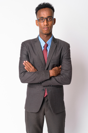 Portrait of young handsome African businessman with eyeglasses crossing arms Stock Photo