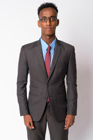 Portrait of young handsome African businessman with eyeglasses