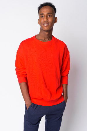 Portrait of young happy African man thinking