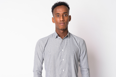 Portrait of young handsome African businessman looking at camera