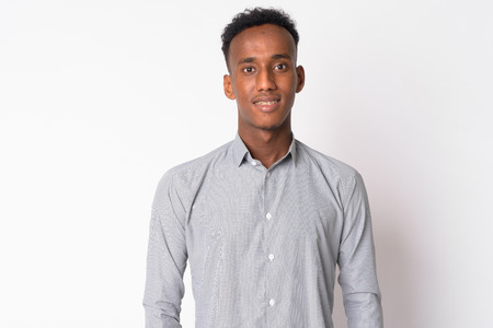 Portrait of young happy African businessman smiling Stock Photo