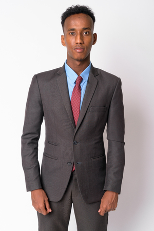 Portrait of young handsome African businessman in suit Stock Photo