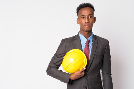 Portrait of young handsome African businessman with hardhat