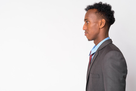 Profile view of young handsome African businessman in suit Stock Photo