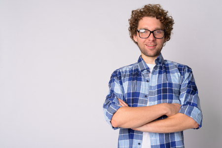 Portrait of happy hipster man smiling with arms crossed Stock Photo