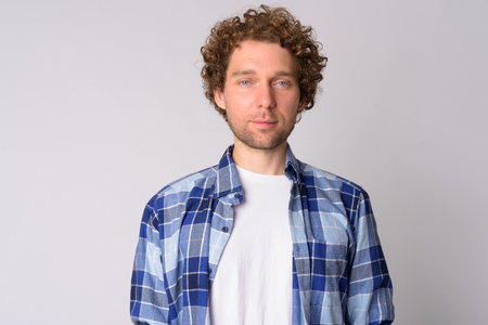 Portrait of handsome hipster man with curly hair
