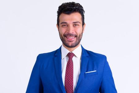Portrait of happy bearded Persian businessman smiling