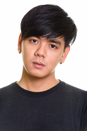 Face of cool handsome Asian man against white background