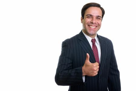 Prise de vue en studio d'un jeune homme d'affaires persan heureux souriant tout en donnant